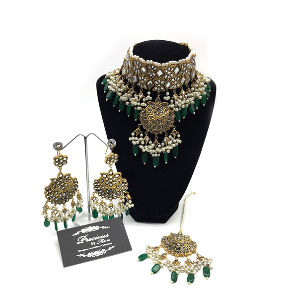 Antique kundan choker with matching earrings and tikka in emerald and pearl droplets