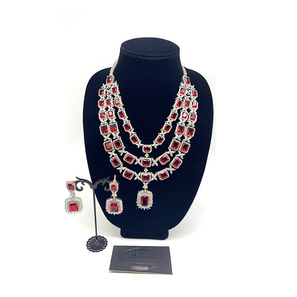 American diamonds layered set with red centre stone